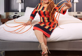 Meet the Woman with the Longest (18-foot-long) fingernails